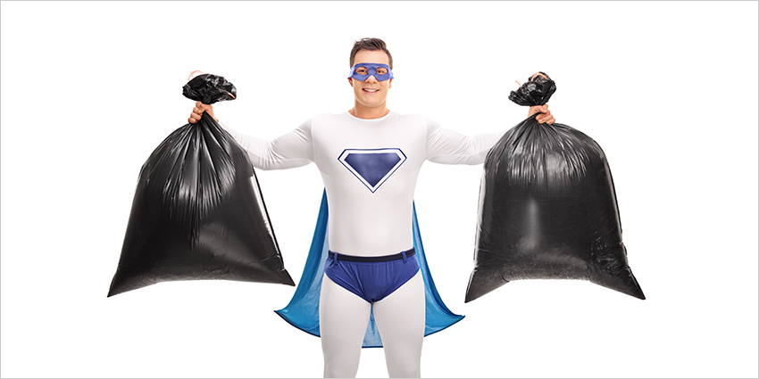 Superhero holding two trash bags
